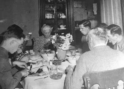 Ida and Henry Twisselmann sharing Sunday Dinner with soldiers from Camp Roberts     courtesy of Roy Twisselmann