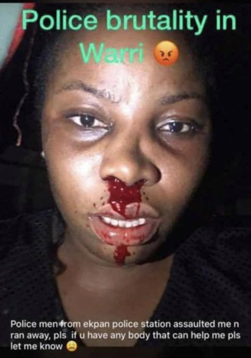 Police Officer Hits A Lady With Gun In Warri As She Bleeds From Nose (Graphic)