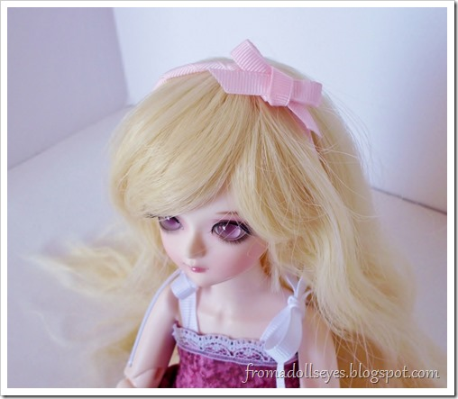 Cute pink ribbon headband for dolls.