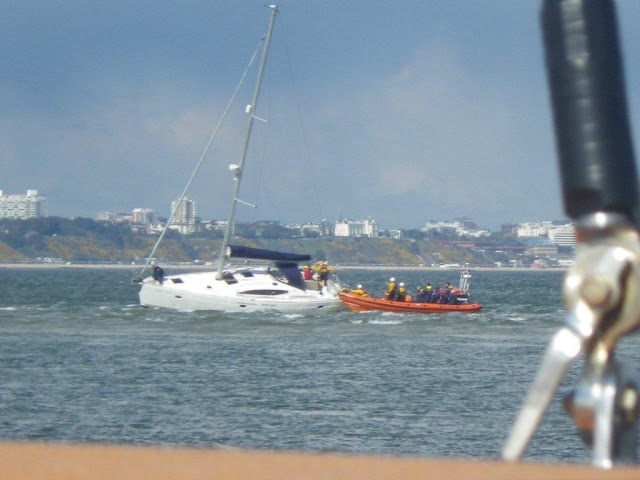 Poole ILB crew taking 6 of the 9 crew off a yacht aground on Hook Sands - 27 April 2013 Photo: RNLI/Anne Millman