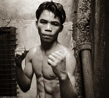 TOUCHING: photo story of how Manny pacquiao fought his way out poverty