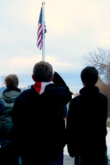 Jacob Brown, an 11-year-old Boy Scout, looks on at the Veterans' Day flag dedication ceremony held at the Bozeman Public Library. Photo by Abigail Redfern.