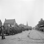 People of Aalst, the Netherlands welcome a column of the Irish Guards. Date: September 18, 1944. Photographer: Willem van de Poll. Source: Dutch National Archive