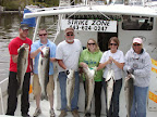 Really nice group of people with their Rockfish limit on May 3, 2014