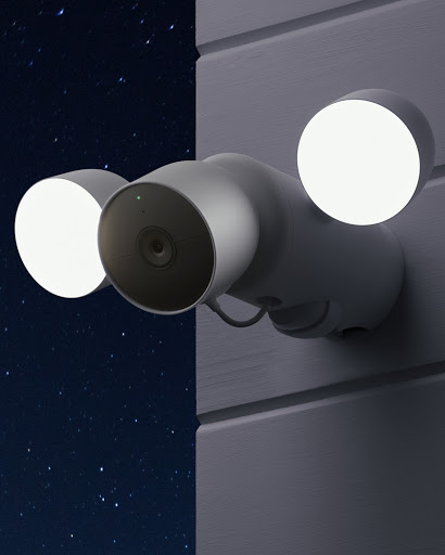 Nest Cam with floodlight shines outside of a home.