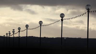 Lamps lighting a pier in Carrickfergus Northern Ireland