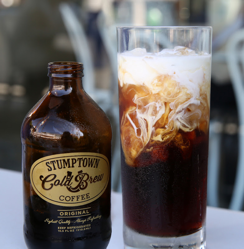 photo of a glass and a bottle of  Stumptown Cold Brew