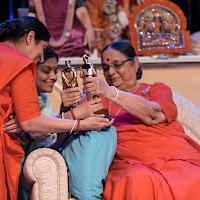 Hansa Didi looking at Award.jpg