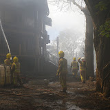 20 April 2012 - Firefighters in action at the scene of the devastating fire on Green Island. Photo: RNLI/Poole Lifeboat Station