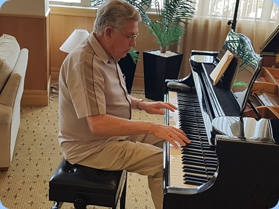 Jim Nicholson playing the Kohler and Campbell grand piano.