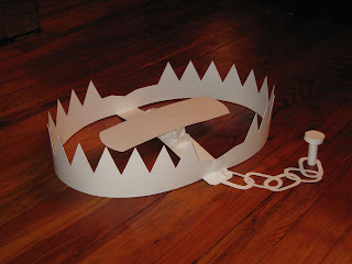 bear trap cut out of creme colored paper