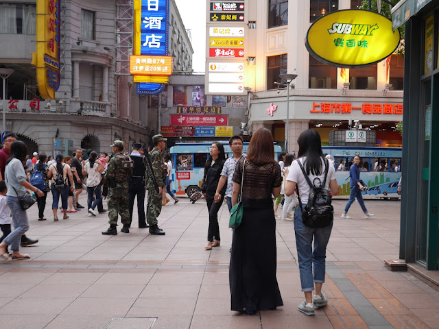 armed police at the Nanjing Road Pedestrian Street in Shanghai