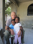 Byron Shewman, pictured with Loveberline and her sister Beatrice at their foster home.