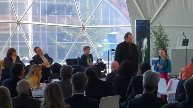 "On 24 January 2019, sixteen year-old climate activist Greta Thunberg addresses a panel in Davos for the World Economic Forum. On the panel are Bono, Christiana Figueres, Jane Goodall, Will.i.am, and Kengo Sakurada. She said, ""Some people, some companies, some decision-makers in particular have known exactly what priceless values they have been sacrificing to make unimaginable amounts of money, and I think many of you here today belong to that group of people."" Photo: Greta Thunberg / Twitter"