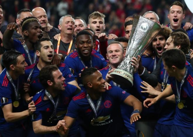 Manchester United's Wayne Rooney and team mates celebrate with the trophy after winning the Europa League. Picture: REUTERS