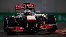Jenson Button on track McLaren MP4-28