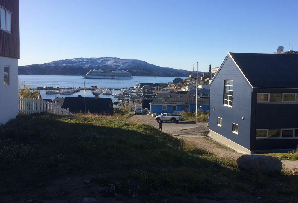 Wandering through the streets of Qaqortoq, Greenland, with Viking Sea in the background (Source: Palmia Observatory)