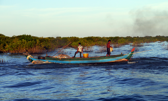 Fishermen at work on Tonlé Sap lake, Cambodia. Photo: Sam Jones / The Guardian