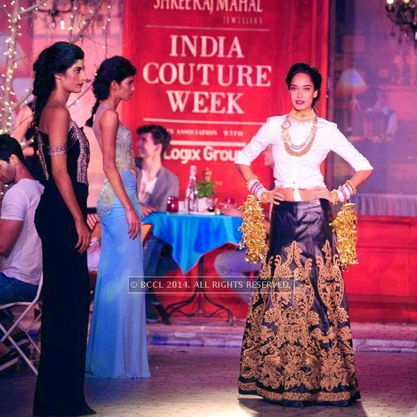 Lisa Haydon walks the ramp for Monisha Jaisingh on Day 3 of India Couture Week, 2014, held at Taj Palace hotel, New Delhi.