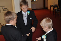 Playing rock, paper, scissors to pass the time as they wait to walk down the isle.