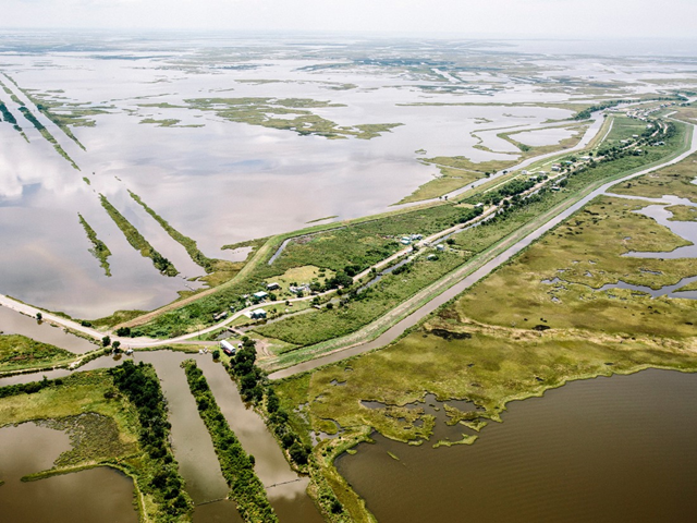 Aerial view of the community of Isle de Jean Charles, Louisiana, shown here in 2015. The land is disappearing in part because of poor river management and climate change. Photo: William Widmer / Redux