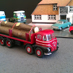 Foden S21 8 wheeler, fictitious livery, inspired by an old black & white photo of a similar lorry carrying a load of logs. Parts used.. FOD5 cab, 2 x W5 wheel sets, B/Toys Chassis, flat scratchbuilt and the load is from a trackside model.