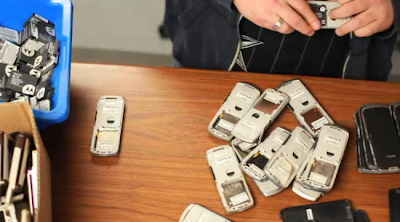 Used cell phones being sorted by a Pacebutler technician