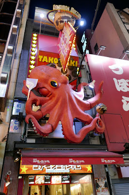 Sights of Osaka - the giant food signs of Dotonbori include an octopus cooking itself into takoyaki?