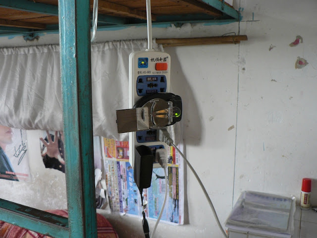 hanging power strip in a dorm room at the Guangxi Normal University for Nationalities in Longzhou, China