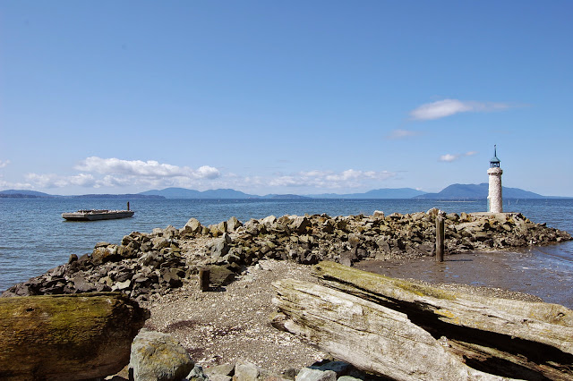 The shore and shell encrusted lighthouse at Taylor Shellfish Farm. / Credit: Bellingham Whatcom County Tourism
