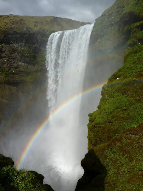 Rainbow over Skogafoss waterfall, Iceland