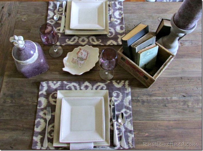 Antique boxes, ikat fabric placemats can really set off a beautiful summer tablescape