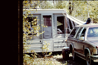Photo: Camper set up half way in; end of the driveway