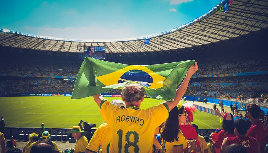 A Brazilian fan cheers for his team during a soccer match