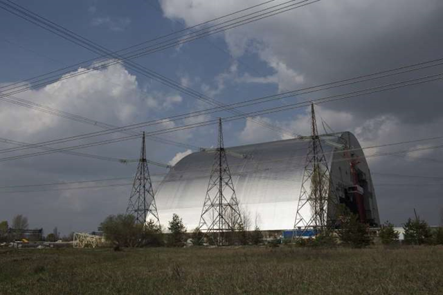The New Safe Confinement arch, a massive steel enclosure that will cover Chernobyl's reactor 4. It will be slid into place in late 2017 over the damaged reactor and its nuclear fuel, creating a leak-tight barrier designed to contain radioactive substances for at least the next 100 years. Photo: John Wendle / The Wall Street Journal