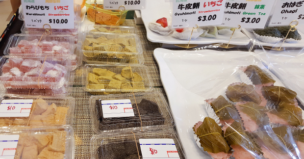 photo of different kinds of mochi in containers