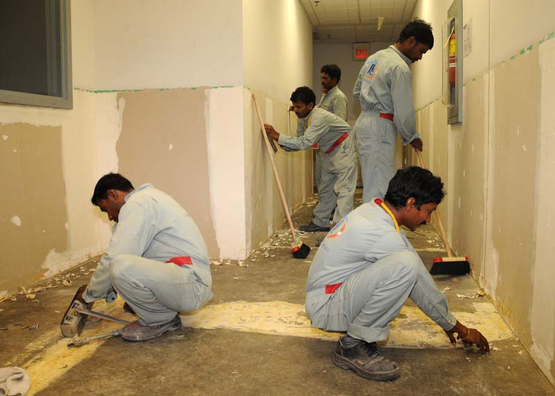 Bahrain - Workers renovate the Naval Support Activity Bahrain Child Development Center. Most manual workers and domestic servants are foreigners from south Asia, India, Pakistan, Philippines, etc.   (photo-Stephen Murphy)