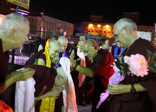Upon arriving in Ulaanbaatar, Lama Zopa Rinopche is greeted by Western Sangha, Mongolia, August 13, 2013. Photo by Ven. Thubten Kunsang.