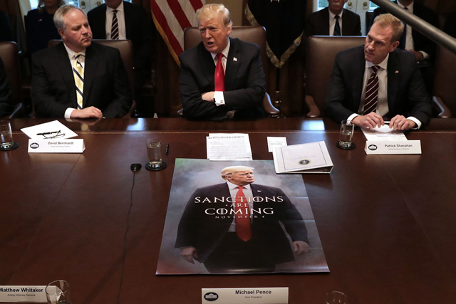 Acting Interior Secretary David Bernhardt, left, joins Trump at a Cabinet meeting on 2 January 2019. Photo: Chip Somodevilla / Getty Images