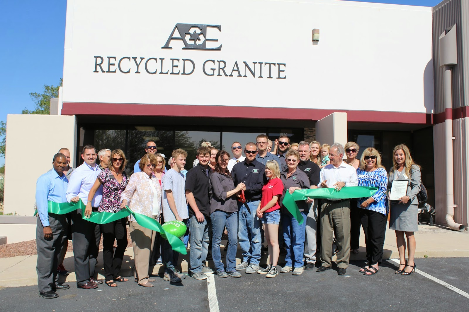 A&E Recycled Granite - Owners Joshua and Julie Olauson performed the Green ribbon cutting, officially opening A&E Recycled Granite, LLC. Corporation members Alfred and Anita Dean, Alfred I. Dean, Vance and Erin Goodman also participated. The event included family members, Mayor Rothschild, Council Member Shirley Scott and 250 guests.