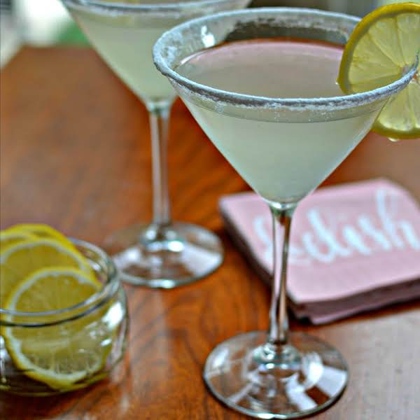This Lemon Drop Martini Is A Lightly Sweetened Lip Smacking Lemon Lovers Treat.  This Vodka Based Cocktail Can Be Prepared In A Couple Of Minutes In A Cocktail Shaker Making It An Easy Party Favorite.