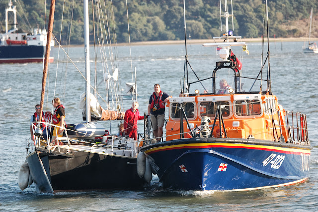 Poole ALB with the yacht in an alongside tow bringing her into Poole Quay Boat Haven. 22 August 2013 Photo credit: RNLI/Dave Riley