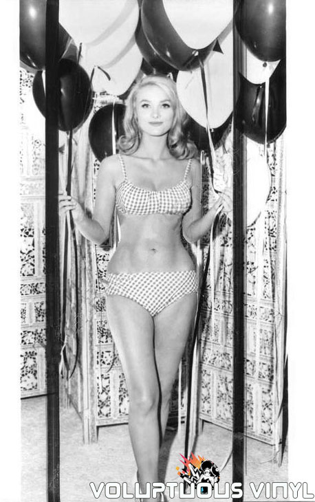 Barbara Bouchet Wearing Bikini and Holding Balloons