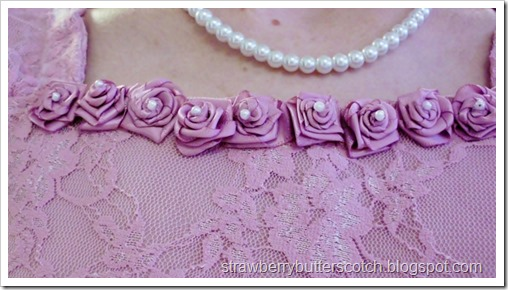 Ribbon roses on neckline of an Easter dress.