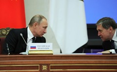 Putin and Ushakov at the meeting of the Supreme Eurasian Economic Council.
