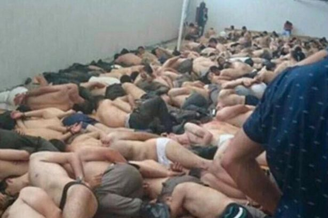 Captured Turkish soldiers are stripped, bound, and piled into a room, after the failed coup on 15 July 2016. Turkish troops, imprisoned after the failed military coup, are being raped, starved, and left without water for days. Many of the 10,000 detainees are locked up in horses' stables and sports halls, some hogtied in horrific stress positions, according to Amnesty International. Photo: Daily Mirror