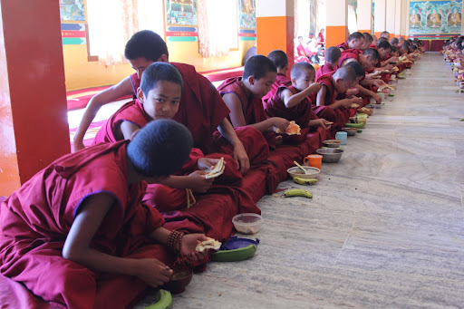 small monks enjoying the food