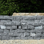 Dry stone wall of squared rubble stones