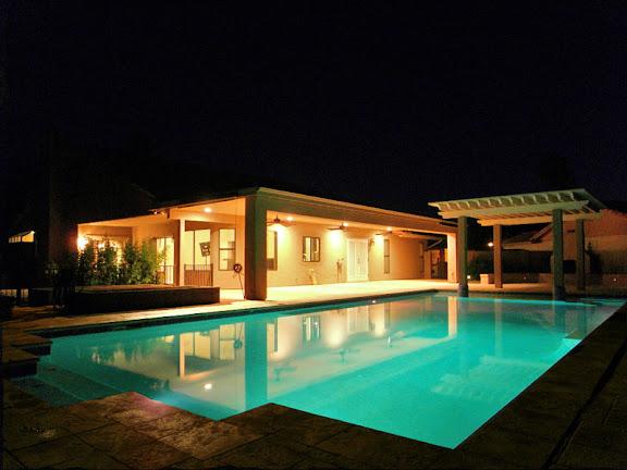 Sun Lakes AZ Real Estate resort style pool at night
