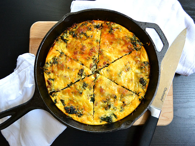 Top view of cooked kale & chorizo frittata in cast iron skillet